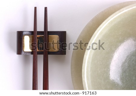 chinese chopstick and jade bowl - stock photo