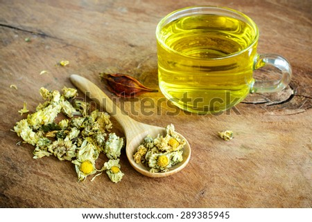 Chinese Chrysanthemum Tea on old wooden table - stock photo