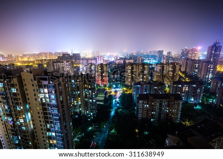 Chinese city apartment building at night - stock photo