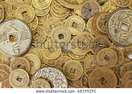 Chinese Coins in a Pile as Background - stock photo