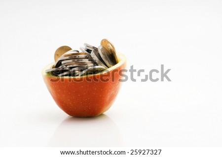 Chinese coins in apple - stock photo