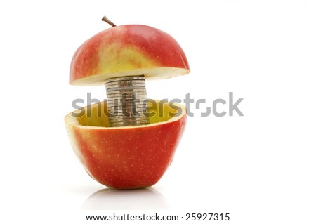 Chinese coins in red apple, isolated on white - stock photo