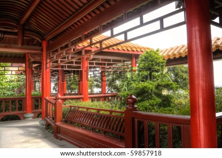 Chinese corridor in with red pillar and yellow roof, architecture interior of temple.