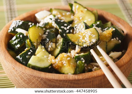 Chinese cucumber salad with sesame seeds macro in a bowl. Horizontal - stock photo