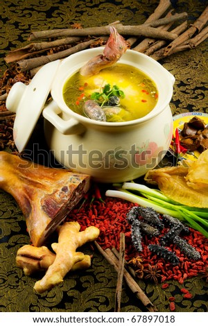 chinese cuisine, chicken soup in the pot with food stuff