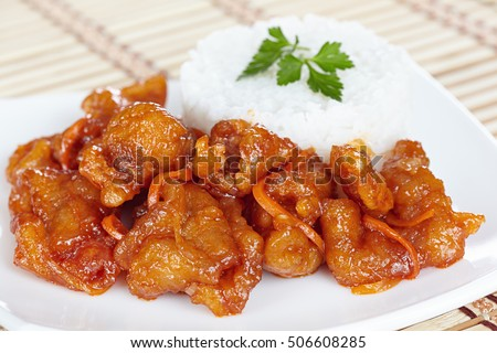 Chinese cuisine. Pork in batter and sweet and sour sauce