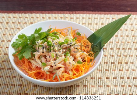 chinese cuisine .salad of shrimp, mixed greens