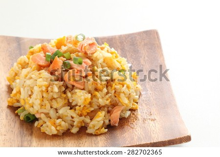 Chinese cuisine, salted Salmon fish and egg fried rice - stock photo