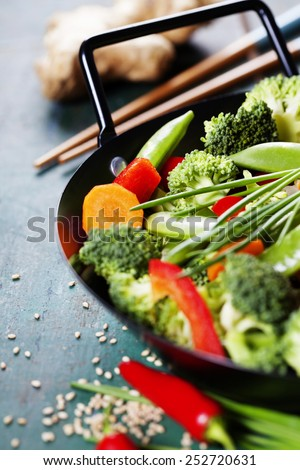 Chinese cuisine. Wok cooking vegetables. Vegetarian wok - stock photo