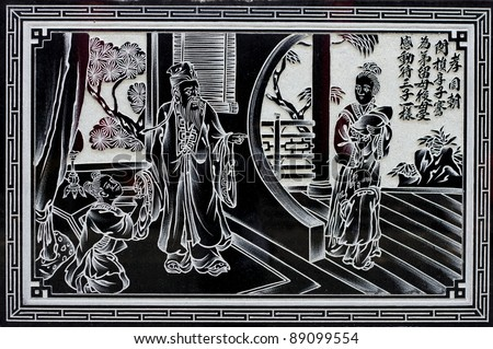 chinese culture wall statue in a temple - stock photo