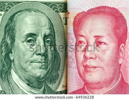 Chinese currency yuan and U.S. dollars amerkinaische bills - stock photo