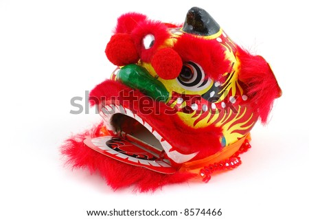 Chinese dancing lion head decoration in isolated white background - stock photo