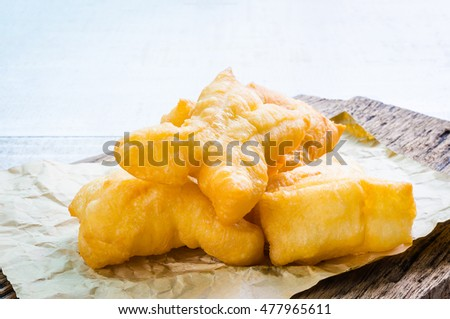Chinese deep fried dough sticks on brown paper, breakfast in Thailand