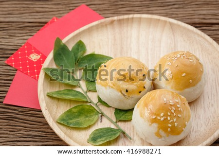 Chinese dessert with red envelope ,chinese festival concept - stock photo