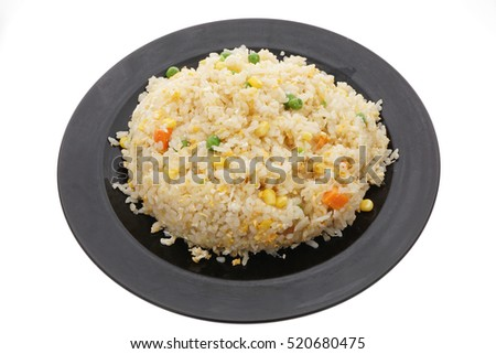 Chinese dish. Chinese food. Rice with eggs and vegetables, in black plate isolated on white. Closeup.