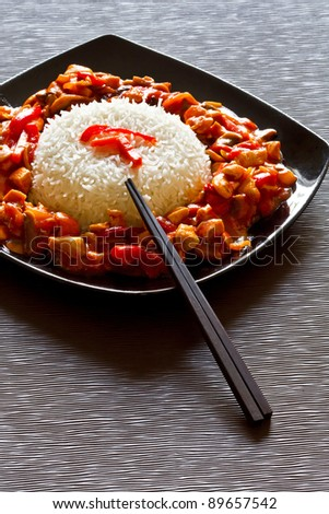 Chinese dish with szechuan chicken and rice - stock photo