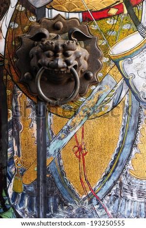 Chinese door with a lion hand door - stock photo