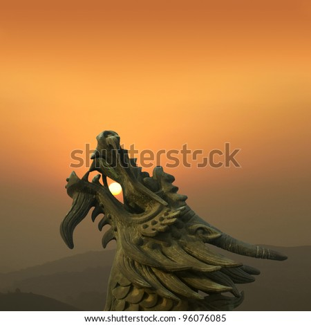 Chinese dragon at dusk in the background - stock photo