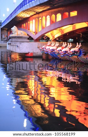 Chinese Dragon Boat in a modern city - stock photo
