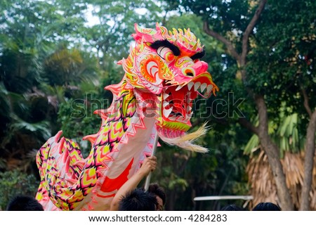 Chinese Dragon dancing around during a performance - stock photo