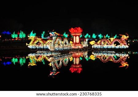 Chinese Dragon Lantern on pond - stock photo