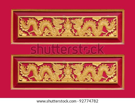 Chinese dragon on old red wood - stock photo