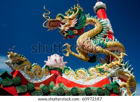 Chinese dragon on oriental temple roof - stock photo