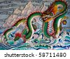 Chinese dragon on wall at Chinese temple - stock photo
