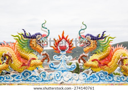 Chinese dragon statue above the entrance to a Chinese temple - stock photo