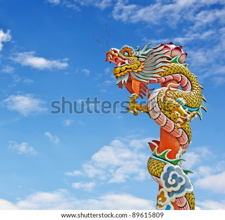 Chinese dragon statue and blue sky - stock photo