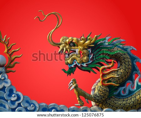 chinese dragon statue  on red background