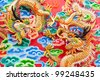chinese dragon statue  on temple wall in Thailand - stock photo