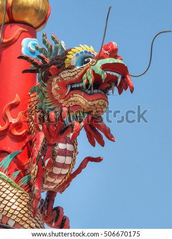 Chinese Dragon statue on the blue sky