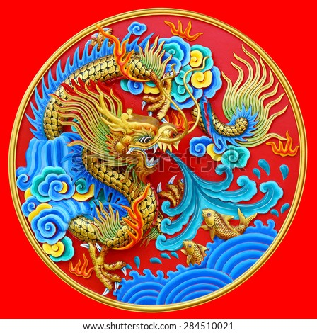Chinese dragon statue on the wall background - stock photo