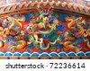 Chinese dragon statue on the wall of Chinese temple - stock photo