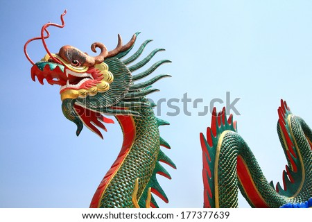 Chinese dragon statue with clear sky. - stock photo