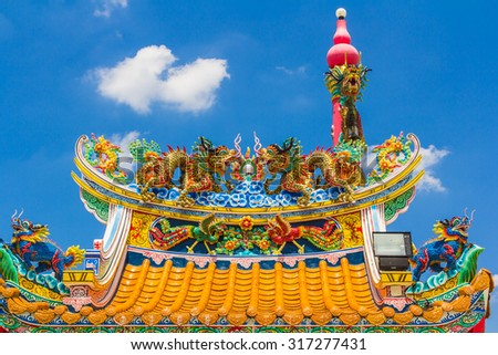 Chinese dragon with blue sky - stock photo