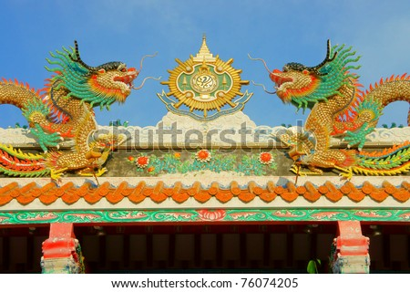 Chinese dragons on a temple in Thailand. - stock photo
