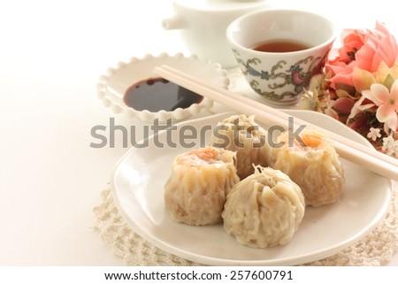 Chinese dumpling, assorted dim sum Shumai and xiaolongbao  - stock photo