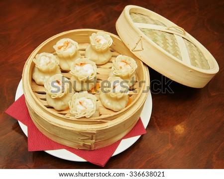Chinese dumpling with chopsticks - stock photo