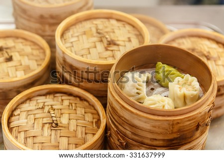 Chinese dumplings with meat and cabbage, steamed with bamboo steamer - stock photo