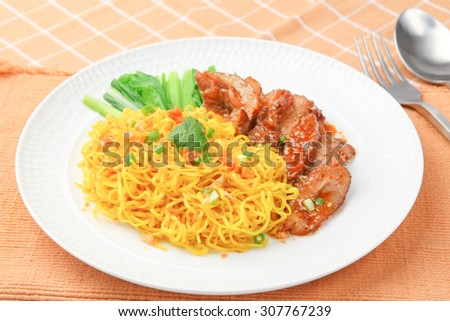 Chinese egg noodles with grilled pork  - stock photo