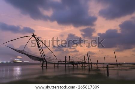 Chinese fishing at Fort Kochi, Kerala, India - stock photo