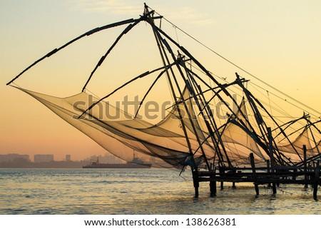 Chinese fishing net at sunrise in Cochin (Fort Kochi), Kerala, India - stock photo
