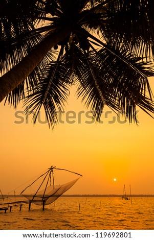Chinese fishing net at sunset in Cochin (Kochi), Kerala, India - stock photo
