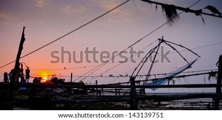 Chinese fishing nets of Fort Cochin during the sun set, Kochi, India