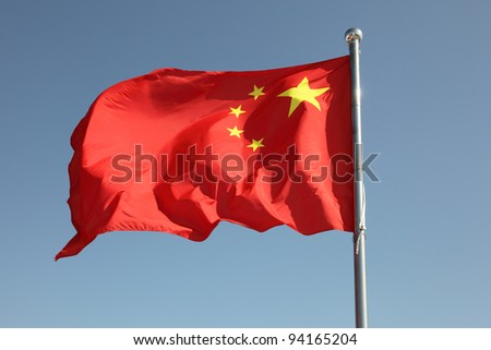 Chinese flag against a blue sky - stock photo
