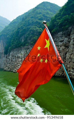 chinese flag flying from a boat on the yangtze river in china - stock photo