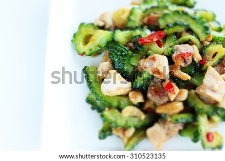 Chinese food, bitter melon and chicken stir fried - stock photo