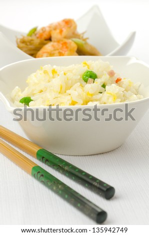 Chinese food dishes, fried rice and noodles with prawns - stock photo